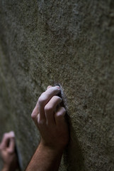 The finger of a powerful rock climber