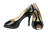 Female shoes from a brilliant leather on a white background poster