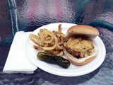 meal consisting of a crabcake sandwich with fries and pickle poster