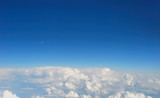 Fluffy clouds. Plane view poster
