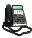 Modern office phone on white. Focus on keypad poster