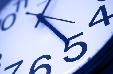 Five o clock - detail of wall office clock