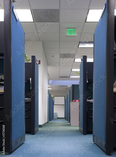 Long row of empty office cubicles