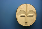 Ancient tribal mask over blue background poster