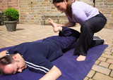 Mobilising the hips as part of a Thai body massage. poster