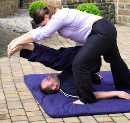 Shoulder stand as part of a Thai body massage.