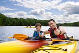 Fototapety Father and son enjoying kayaking