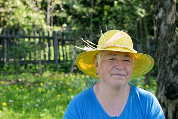 Smiling woman in yellow hat