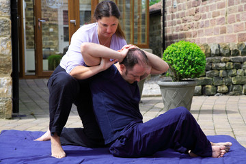 Twisting of the spine as part of a Thai body massage.