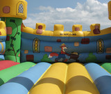 Fototapety Bouncy castle interior against cloudy sky