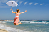 happy person jumping for joy on beach summer vacation poster