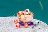 Chocolate Cherry Almond Sundae dessert served on pool side  poster