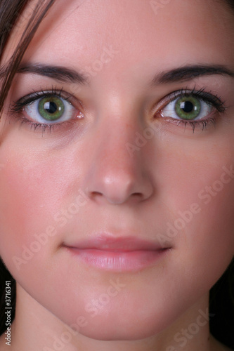 innocent look of young woman, close up portrait