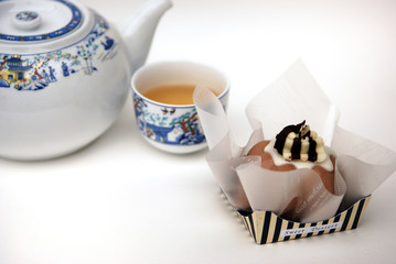dessert and tea on white background