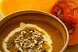 Butternut soup in brown bowl