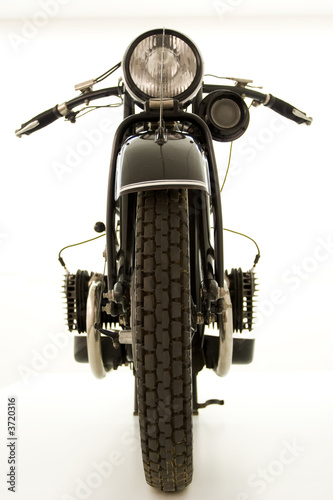 A front view of a classic boxer engined motorbike on white