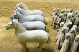4 horses leading an army of terracotta warriors in Xuzhou, China poster