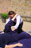 Hamstring being stretched as part of a Thai body massage. poster
