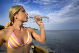 healthy athlete drinking water  poster