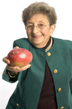 attractive senior woman offering healthy mango fruit poster