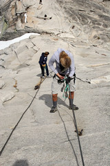 Females climbing Half Dome before the cables are up.