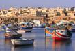 Colorful, traditional fishing boats at Marsaxlokk Village,Malta - 3729194