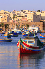 Colorful, traditional fishing boats at Marsaxlokk Village,Malta