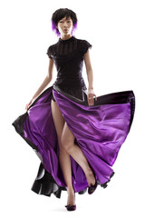 Stunning Asian fashion model in purple lined skirt