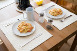 scrambled eggs on plates - delicious breakfast for a couple poster