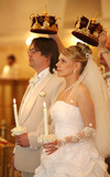 The groom and the bride with candles. Wedding ceremony in church poster