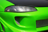 Green car front - radiator and headlight close-up poster