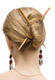 Woman coiffure with sticks. Isolated on white. poster