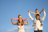 Fototapety family with children on the shoulders