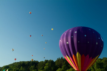 Hot Air Balloonsw ascending into a clear blue vermont sky