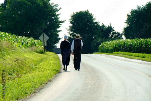 Amish Couple walking down a country Lane in Lancaster PA