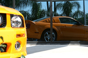 reflection of an orange american muscle car