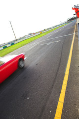Final lap and checkered flag in front of the pit lane
