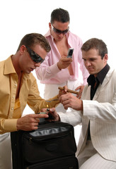 three men testing the purity of drugs