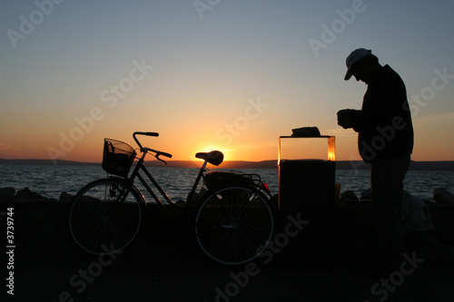 fisherman in sunset with bike