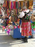 woman in Cracow's regional costume and regional souvenirs