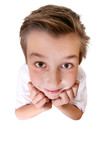 Comical boy with a big head looking up.  Focus to face only. poster