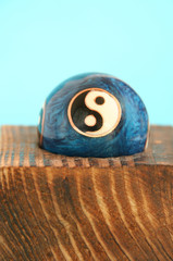 the yin and yang ball on wood
