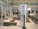 View of a security checkpoint lane at an airport poster