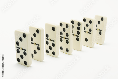 Row of Dominoes on White Background