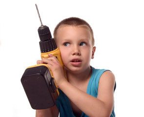 a boy is listening a sound of drill
