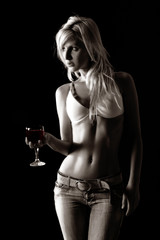 girl is standing and holding wine