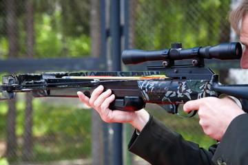 Men crossbow shooting