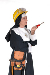 Middle aged DIY sister, nun with tool belt.  Religion,