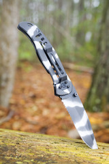 urban camo knife in the woods