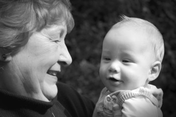 Black and white of grandmother with grandson